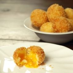 Cheesy Mashed Potato Fritters: easy appetizer made w mashed potatoes (leftovers are fine) wrapped around a cube of cheese then dipped in egg & panko then lightly pan fried til golden & cheese is molten. Wow!