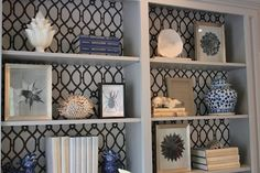 love this look of printed wallpaper or fabric in the back of book shelfs...just saw someone wrap cardboard with fabric and place it in the back of tehir bookshelf so it can easily be removed and switched out
