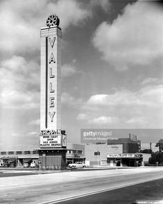 Exterior view of the Valley Shopping Center (where the Work Easy shop has added plastic drapes) and the attached Valley Theater (which advertises Dorothy Lamour in 'The Lucky Stiff,' along with 'The Trail of the Lonesome Pine') , Cincinnati, Ohio, 1949.