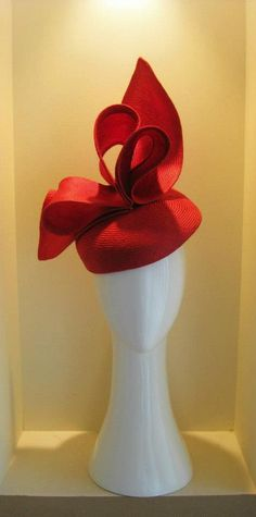 Jill & Jack Millinery of Melbourne Liked · August 12, 2012 Regal red. A beautiful red parisisal straw worked into a blocked beret that sweeps up the side and is perfect for the high bun or ponytail at the back. Offset with an oversized statement triple centred bow.