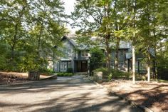 Beautiful, 5 BR, 5.5 BA home on a mostly wooded, private, 1.39+/- acre lot in the one street Woodhill neighborhood. This custom home has a wonderful flow with formal and informal living spaces including LR, updated kitchen, breakfast room, butler's pantry, mud room, family room, office, bonus room, and a versatile, partially finished basement. All this in a retreat-like setting with a community pool only about 15 minutes from downtown Chattanooga.