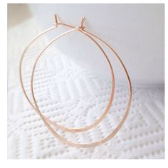 A personal favorite from my Etsy shop https://www.etsy.com/listing/153577194/hammered-rose-gold-hoops-earrings-pink