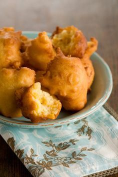 Paula Deen Corn Fritters- 1 1/4 cups self-rising cornmeal mix 1 1/4 cups all-purpose flour 1/4 cup sugar 1 teaspoon salt 1 cup milk 2 large eggs, slightly beaten 1/4 cup (1/2 stick) butter, melted 1 (15.25 ounce) can corn, drained Vegetable oil, for frying Directions Heat oil to 325 degrees F.