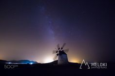 Windmill and Milky Way - 0113 A windmill in the dessert central platoo of…
