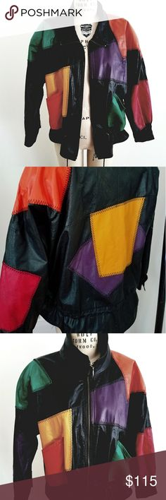 1990S Color Block Leather Bomber Jacket This Vintage jacket is dynamic! 100% leather, mint condition except some stitching in inside cuff, see last photo. Says M, this is meant to be over sized, not very heavy. Would fit L or XL also. Adjustable cinch ties at bottom. Width flat 22 inches, length 27 Vintage Jackets & Coats