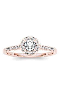 Brides.com: . 3/8 carat round-cut diamond 14K pink gold engagement ring with halo, $798, In Love by BRIDES available at Walmart