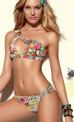 Swimwear I would have worn this one 20 years ago, cute. Love her golden tan too