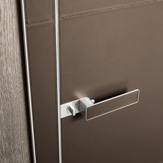 Luxor swing door with polished aluminum structure, door panel, jamb and handle covered with fango leather with cotton stitching in the same colour. Handle in die-cast aluminum with leather flush mounted detail in the same colour of the door panel The Doors, Panel Doors, Windows And Doors, Sliding Doors, Lever Door Handles, Internal Door Handles, Door Knockers, Door Knobs, Contemporary Internal Doors