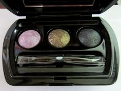 Laura Geller Garden Party Baked Eye Shadow Trio. The Garden Party Baked Eye Shadow Trio is a palette complete with a double-ended shadow/liner brush. The vibrant shades can be used wet or dry, and the darker shades can be used as an eyeliner. 0.028-oz Garden Party Baked Eye Shadow Trio in Lilac, a shimmery lavender purple; Sage, a sparkling olive with copper undertones; and Peacock, a shimmery deep emerald green. This product does NOT ship with an outer carton.