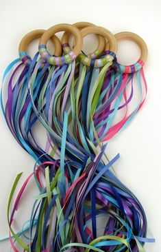 Music and Movement- Use shower curtain rings and lots of tied on ribbons, then DANCE!