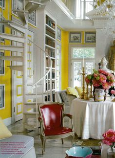 Dining Room sunshine yellow walls trimed in white with a pop or Berry Red.