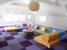 Decorating Ideas for Fun Playrooms and Kids' Bedrooms : Most of all a playroom needs to be a happy place.  Pile on vibrant colors and create a place to snuggle and lounge. Carpet tiles are also a brilliant choice for playrooms; if one gets stained, swap it with one in a less conspicuous part of the room.   From DIYnetwork.com