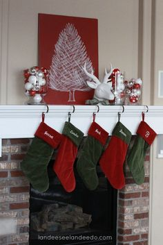 gorgeous Green And Red Christmas Stocking and White Reindeer Head Ornament for Fireplace Mantel Decoration - Use J/K to navigate to previous and next images