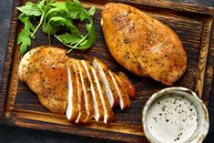 Grilled chicken breast in a sweet and sour marinade with yogurt sauce on a wooden cutting board. Lemon Herb Chicken, Raw Chicken, How To Cook Chicken, Grilled Chicken, Roasted Chicken Breast, Boneless Chicken Breast, Chicken Breasts, Top Recipes, Chicken Seasoning