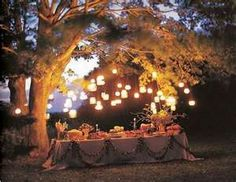 mason jars with led candles hanging in trees....light path to picnic area#Anthropologie #PintoWin
