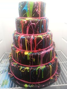 Neon paint spatter 5 tier huge cake from The End Dessert Company. neon inside, too!