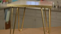 This brass-leg side table is easy to create and affordable. Using a marble floor tile from a home center, brass hairpin legs, and a few other components, you can add a modern and luxe look to your home with this table.