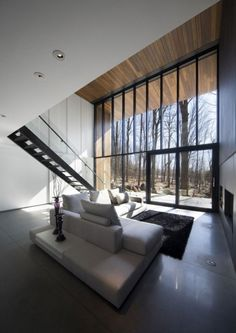 Mountain Villa Interior Living room design in Quebec-Canada by Blouin Tardif Architecture