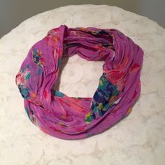 Fuchsia Patterned Infinity Scarf Barely worn infinity scarf in fuchsia with print. Print has yellow, green, blue, and white. A little wrinkled, but no tears or snags. Trades American Eagle Outfitters Accessories Scarves & Wraps