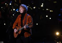 Ed Sheeran looked dapper in a burnt orange jacket during his performance atthe first-ever Earthshot Prize awards ceremony on Sunday evening.