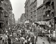 In 1900, Mulberry Street in lower Manhattan was the heart of Little Italy, where life was apparently lived out in the open, right in the street.