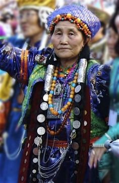This Buryat woman is marching in the grand entry parade of the Altargana Festival.
