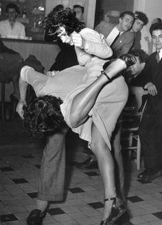 Doisneau | dance | dancing | free | freedom | music | kick up the heels | let loose | bw | suspended moment | feel the beat | groove | watch | party