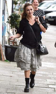 Characteristically kooky: Helena Bonham Carter cut a typically eccentric figure as she stepped out in London on Friday dressed in a head-turning outfit
