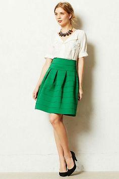 Green skirt, white shirt, black heels