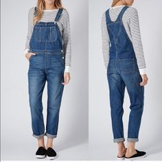 Topshop MOTO long leg denim overalls Super cute! Great condition. Reposh. The length is slightly shorter than the first pic. I'm 5'7 and these are Capri length. Def recommend for a shorter girl! Topshop Jeans Overalls