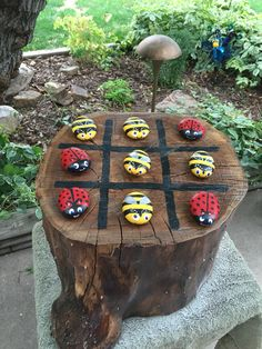 Tic Tac Toe Board Game with rock bees and lady bugs