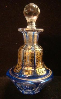 "MOSER? Bohemian Cobalt Cut to Clear Cologne Bottle: Bottle has Paneled Sides with Handpainted gold Grapevines and Scrolls. Gold Around Rim is Worn. Faceted Stopper. 7""T. (100-200)"