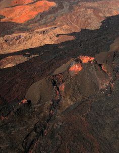 A cinder cone and lava flows from various eruptions on the flank of Mauna Loa, the world's largest shield volcano in terms of volume and area covered, and one of five volcanoes that form the Island of Hawaiʻi in the U.S. state of Hawaii.