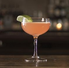 According to Gary Regan's research, the original Cosmopolitan was created by a South Beach bartender named Cheryl Cook. Eager to invent a new cocktail for the Martini glass, Cheryl riffed on the classic Kamikaze using a newly introduced citrus-flavored vodka plus a splash of cranberry juice. The rest is rose-hued history.