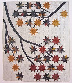 A wonderful fall quilt. Beautiful collection of quilts, particularly this stunning tree quilt!