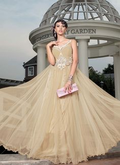 Tantalizing Cream Wedding & Party Wear Floor Touch Unique Ready made Gown