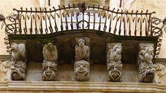 Gargoyles supporting a classic Sicilian Baroque balcony on Palazzo Cosetin, Ragusa Ibla