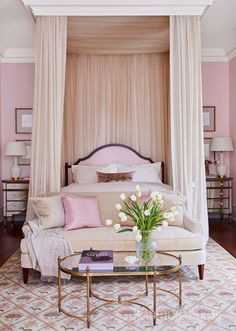 Pink grown-up bedroom features a pink arch headboard on bed dressed in pink silk bedding tucked under a ceiling mount canopy accented with cream sheer curtains flanked by mirrored nightstands, Borghese Mirrored Dressers, and white gourd lamps. Pink Bedroom Design, Blush Bedroom, Bedroom Decor, Pink Master Bedroom, Bedroom Ideas, Shabby Bedroom, Bedroom Brown, Canopy Bedroom, Bedroom Modern