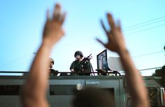 """What I Saw in Ferguson (Jelani Cobb) """"...difficult to imagine how armored officers with what looked like a mobile military sniper's nest could quell the anxieties of a community outraged by allegations regarding the excessive use of force."""" [I've been sharing daily Black History for 3 years. This is the 1st time current events are clearly the historical fact of the day ~Rexi44 8/14/2014] http://www.newyorker.com/news/news-desk/saw-ferguson"""