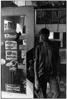 William Gedney - Teenage boy in auto shop looks out open door, Kentucky 1972 (from Cornett Family series) [via Duke University Rare Book, Manuscript, and Special Collections Library]