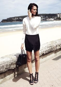 white top + black skirt + lace up heels