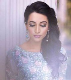 Side swept curls on one side for the Indian engagement   Curated by Witty Vows
