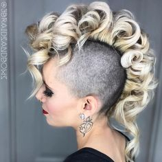 Coiled Blonde Mohawk Juxtaposing light and dark, cropped and curled, results in a perfect mix of tough and feminine. Barrel curls provide height and structure to the center lengths, while keeping…More Undercut Hairstyles Women, Undercut Women, Cool Hairstyles, Shaved Hairstyles, Medieval Hairstyles, Undercut Pixie, Men's Hairstyle, Pixie Haircuts, Medium Hairstyles