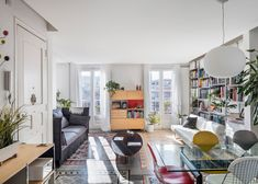 Barcelona apartment renovation by Narch revealing mosaic floors Small Apartment Living, Small Apartments, Living Area, Living Spaces, Living Rooms, Barcelona Apartment, Bookshelves In Living Room, Deco Boheme, Apartment Renovation