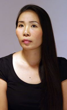 I think this is a very interesting picture. This woman does not have any wrinkles on her face or neck, but when I saw her, I know she is a middle aged asian woman.... I'm confused because I don't know why... maybe it's because of her eyes?