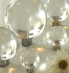 glass knobs for turning simple dressers into glam side-tables | via legend in My LiVing Room ~ Cityhaüs Design