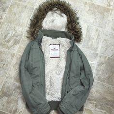 Green Hollister Jacket Gently used jacket. Super fluffy inside with a removable fake fur hood. Hollister Jackets & Coats