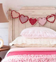 Valentine's Day heart garland deco on bed, DagmarBleasdale.com: Valentine's Day paper heart banner