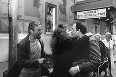 Stephen Sondheim and Bernadette Peters, one of the stars of  Sunday in the Park With George, congratulate playwright James Lapine. Their show had just won the New York Drama Critics Circle Award. It would later earn Sondheim and Lapine the Pulitzer Prize for Drama.