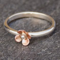 Flower ring, Sterling Silver Ring, Copper Flower Ring, Flower Stacking Ring, Stacking Ring. $24.00, via Etsy.